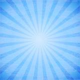 在蓝色背景的抽象光芒。 免版税图库摄影