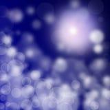 在蓝色背景的抽象模糊的光 库存图片