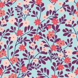 在蓝色背景的无缝的花卉模式 小桃红色和红色花 也corel凹道例证向量 免版税库存图片