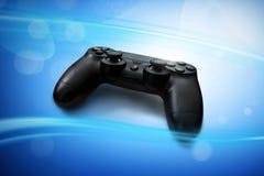 在蓝色背景的电子游戏控制器 免版税图库摄影