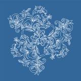 在蓝色背景的白色手拉的装饰品 图库摄影