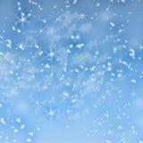 在蓝色背景的美丽的落的圣诞节雪 抽象 设计 背景看板卡祝贺邀请 衣服饰物之小金属片,雪花,星 免版税图库摄影