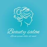 在蓝色背景的美容院商标 库存图片