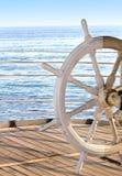 在蓝色背景的船船舵 免版税图库摄影