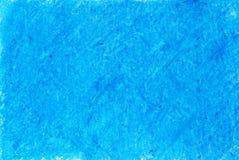 在蓝色背景的蜡笔 免版税库存图片