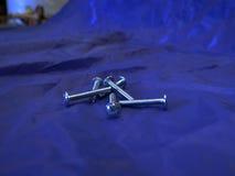 在蓝色背景的螺栓 免版税库存图片