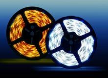 在蓝色背景的被带领的二极管发光的卷 免版税库存图片