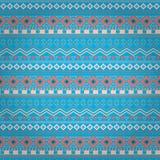 在蓝色背景的部族种族无缝的条纹样式 库存照片