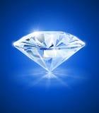 在蓝色背景的金刚石 免版税库存图片