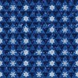 在蓝色背景的雪花 免版税库存照片