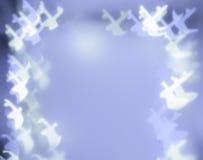 在蓝色背景的驯鹿形状的bokeh光 库存图片