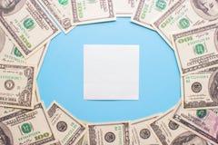 在蓝色背景的100美金 免版税库存照片