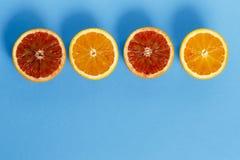在蓝色背景隔绝的桔子 免版税图库摄影