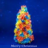在蓝色背景,圣诞节概念的圣诞树 库存照片