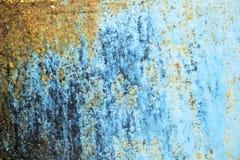 在蓝色钢板的铁锈背景图形设计的 库存照片