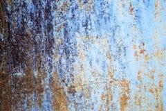 在蓝色钢板的铁锈背景图形设计的 图库摄影