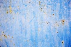 在蓝色钢板的铁锈背景图形设计的 库存图片