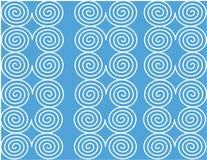 在蓝色页的白色螺旋 免版税库存照片