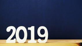 在蓝色颜色背景的新年好信件木字母表 图库摄影