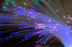 在蓝色,桃红色和绿色的纤维光学与bokeh 库存照片