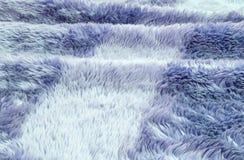 在蓝色织品地毯的特写镜头表面抽象织品样式在房子纹理背景地板  免版税库存照片