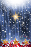 在蓝色满天星斗的背景的星 免版税库存图片