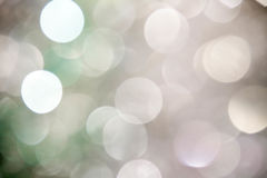在蓝色background.abstract纹理的光 假日bokeh 摘要 圣诞节 欢乐与defocused和星 免版税库存图片