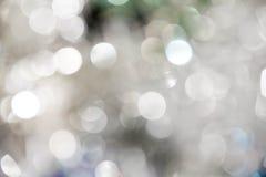在蓝色background.abstract纹理的光 假日bokeh 摘要 圣诞节 欢乐与defocused和星 免版税库存照片