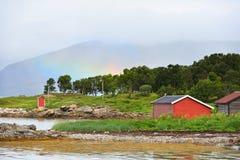 在薄雾的彩虹在北挪威的山 库存照片