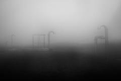 在薄雾的管子 免版税库存照片