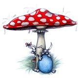 在蘑菇下的逗人喜爱的复活节兔子 库存照片