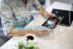 在虚屏上的改善图表 企业和技术概念 库存图片