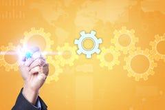在虚屏上的齿轮 经营战略和技术概念 库存照片