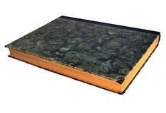 在蛇纹岩盖子的古色古香的书 免版税库存照片