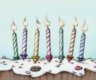 在蛋糕的生日蜡烛 皇族释放例证