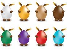 在蛋集合后的复活节兔子 图库摄影