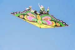 在蝴蝶的形状的风筝 免版税库存照片
