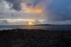 在螃蟹海岛的日落 库存图片