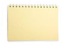 在螺旋的黄色笔记本 免版税库存照片