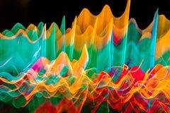在行动的抽象波浪颜色光 免版税库存照片