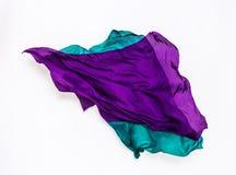 在行动的抽象绿色和紫色织品 免版税库存照片