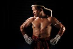 在行动的泰拳男性战斗机 库存图片