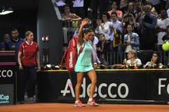 在行动的Tenniswoman 免版税库存照片