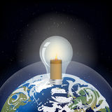 在行星地球的电灯泡 库存照片