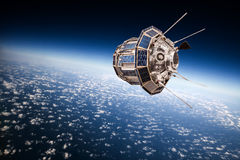 在行星地球的空间卫星 库存照片