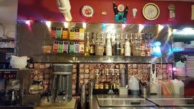 在行星Java吃饭的客人里面的咖啡和饮料驻地 图库摄影