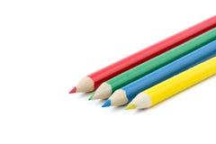 在行的四支五颜六色的铅笔 免版税库存图片