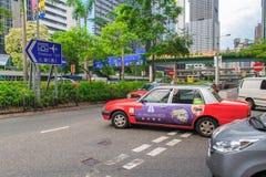 在街道上的出租汽车在香港 90%每日旅客用途公共交通工具 它高级别在世界上 库存图片