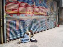 在街道上的叫化子 免版税库存照片