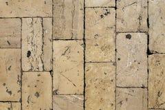在街道上的欧洲瓦片从在对角线的一块石头 图库摄影